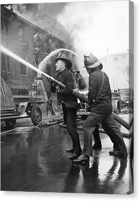 Firemen With Hose Canvas Print by Underwood Archives