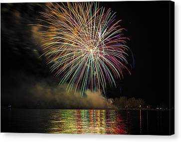 Fireworks And Reflection In Water Canvas Print