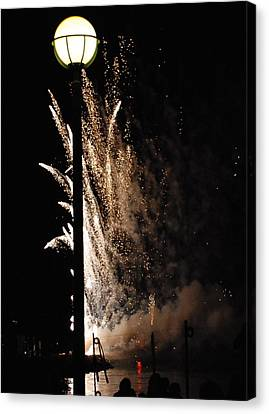 Fireworks Behind The Street Light Canvas Print by Gene Sizemore