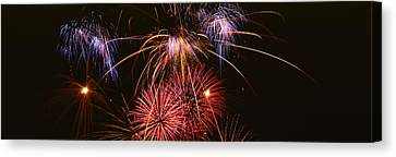 Fireworks Exploding Against Night Sky Canvas Print by Panoramic Images