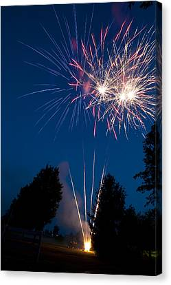 Fireworks Launching And Exploding Canvas Print by Greg Dale