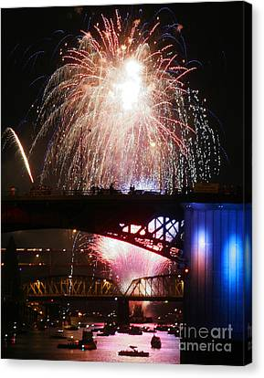 Fireworks Over The River Canvas Print by Keith Dillon
