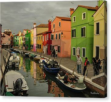 Fisherman At Work In Colorful Burano Canvas Print
