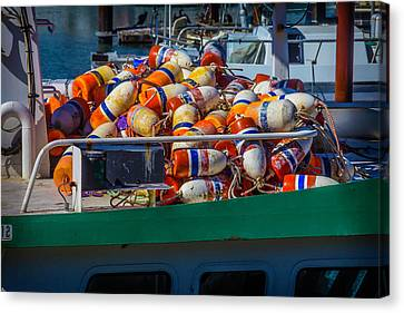 Fishing Bouys On Boat Deck Canvas Print