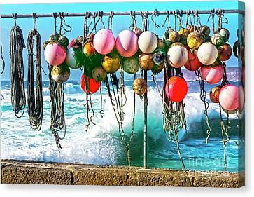 Fishing Buoys Canvas Print by Terri Waters
