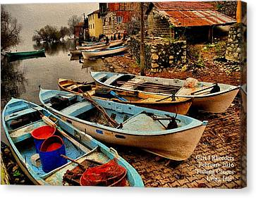 Fishing Canoes Lying Idle L A Canvas Print