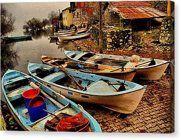 Fishing Canoes Lying Idle L B Canvas Print