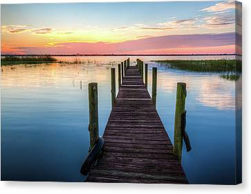 Canvas Print featuring the photograph Fishing Dock At Sunrise by Debra and Dave Vanderlaan