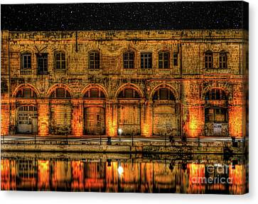 Fishing In Birgu By Old Buildings Canvas Print by Stephan Grixti