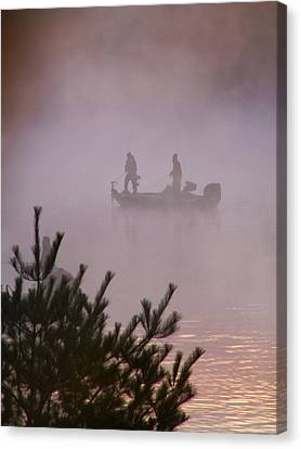 Fishing In The Morning Mist Canvas Print by Nancy Griswold