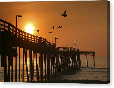 Fishing Pier At Sunrise Canvas Print by Steven Ainsworth