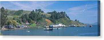 Water Vessels Canvas Print - Fishing Village In Spring Along Highway by Panoramic Images