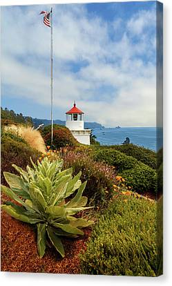 Canvas Print featuring the photograph Flag At The Trinidad Memorial Lighthouse by James Eddy