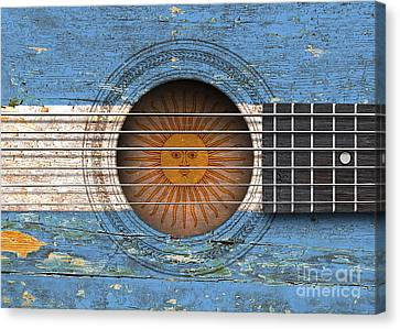 Flag Of Argentina On An Old Vintage Acoustic Guitar Canvas Print by Jeff Bartels