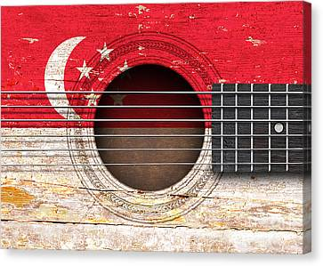 Flag Of Singapore On An Old Vintage Acoustic Guitar Canvas Print by Jeff Bartels