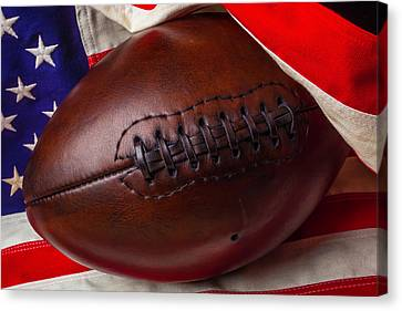 Flag Wrapped Football Canvas Print by Garry Gay