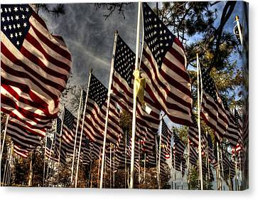 Canvas Print featuring the photograph Flags Flags And More Flags by David Bishop