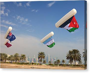 Flags Over Doha Canvas Print by Paul Cowan