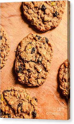 Flame Raisin And Coconut Cookies Canvas Print by Jorgo Photography - Wall Art Gallery