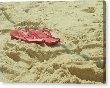 Flip Flops In The Sand Canvas Print by Beverly Hammond