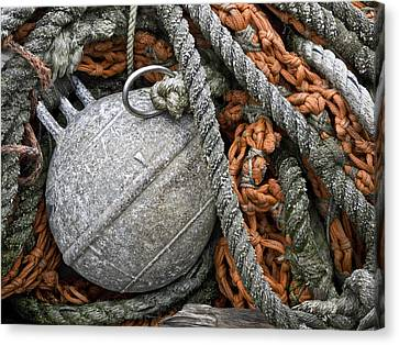 Float And Fishing Nets Canvas Print by Carol Leigh