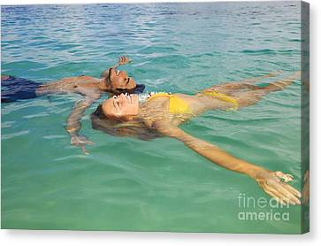 Floating Young Couple Canvas Print by Tomas del Amo - Printscapes