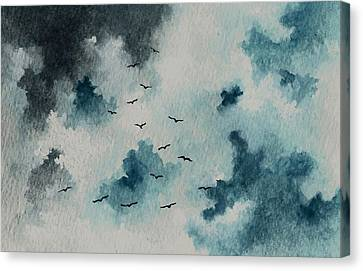 Flock Of Birds Against A Dark Sky  Canvas Print by Michael Vigliotti