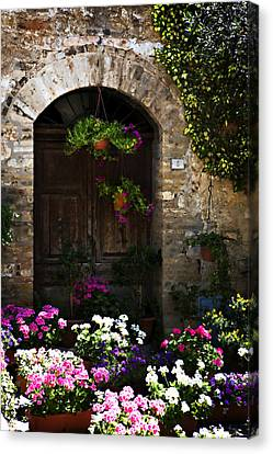 Floral Adorned Doorway Canvas Print by Marilyn Hunt