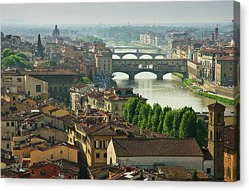 Florence. View Of Ponte Vecchio Over River Arno. Canvas Print by Norberto Cuenca