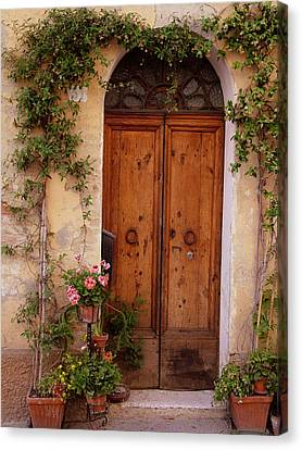 Canvas Print featuring the photograph Flowered Tuscan Door by Donna Corless