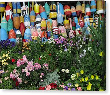 Canvas Print featuring the photograph Flowers And Bouys by Mike Martin