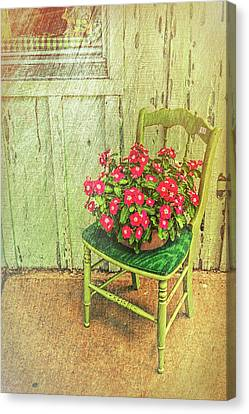 Canvas Print featuring the photograph Flowers On Green Chair by Lewis Mann