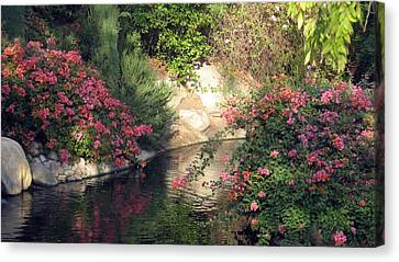 Canvas Print featuring the photograph Flowers Over Pond by Amanda Eberly-Kudamik