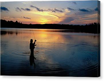 New Individuals Canvas Print - Fly-fisherman Silhouetted By Sunrise by Panoramic Images