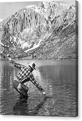 Fly Fishing In A Mountain Lake Canvas Print by Underwood Archives
