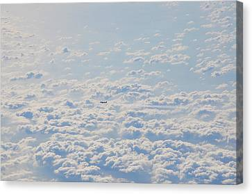 Canvas Print featuring the photograph Flying Among The Clouds by Bill Cannon