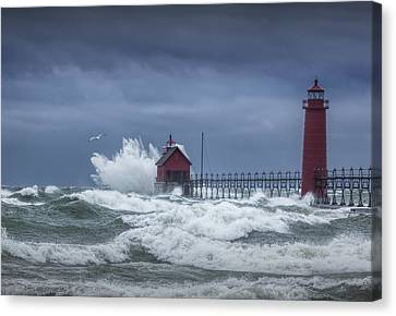 Flying Gull In A November Storm On Lake Michigan By The Grand Haven Lighthouse Canvas Print by Randall Nyhof