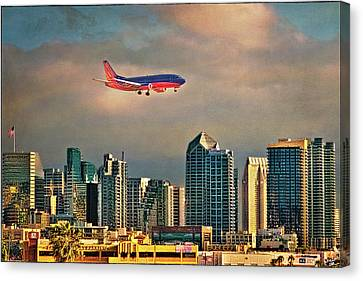 Flying Past Downtown Canvas Print by Chris Lord