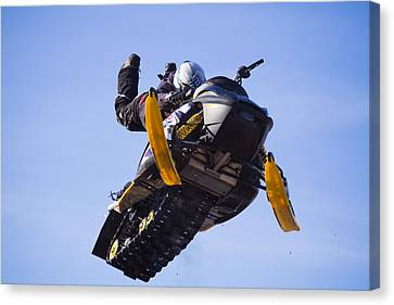 Flying Snowmobile Canvas Print by Mircea Costina Photography
