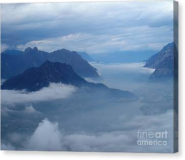 Fog And Clouds Canvas Print by Riccardo Mottola