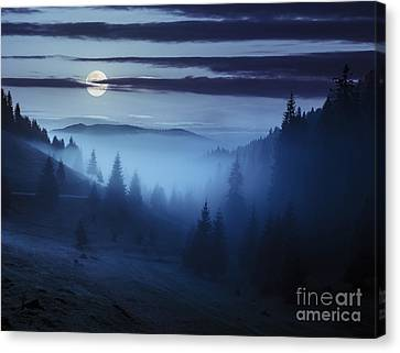 Fog Around The Mountain Top At Night Canvas Print