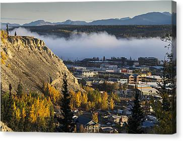 Fog Hangs Over The Yukon River Canvas Print by Mark Newman