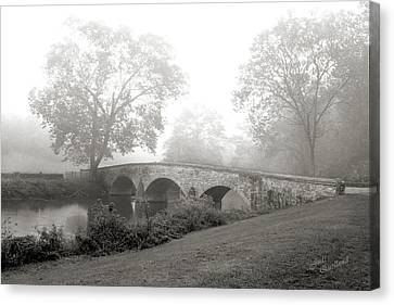Foggy Morning At Burnside Bridge Canvas Print by Judi Quelland