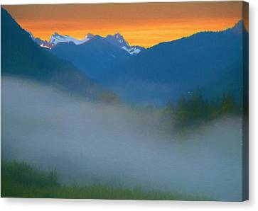 Foggy Sunrise Over The North Cascades Canvas Print by Dan Sproul
