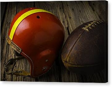 Sports Collectibles Canvas Print - Football Helmet And Football by Garry Gay