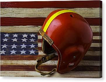 Football Helmet On American Flag Canvas Print by Garry Gay
