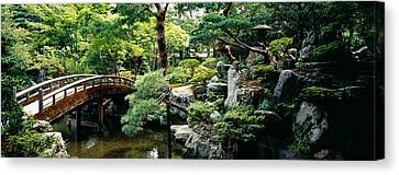 Garden Scene Canvas Print - Footbridge Across A Pond, Kyoto by Panoramic Images