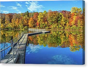 Footbridge Across Lake Canvas Print by Andrew Kazmierski