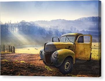 Ford In The Fog Canvas Print by Debra and Dave Vanderlaan