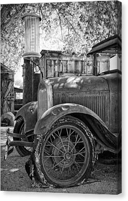 Ford Model A At The Gas Pump Canvas Print by Troy Montemayor